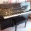 Yamaha C108 Upright piano. Simulated walnut finish